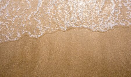 White bubble of Sea wave on fine sand at the beach