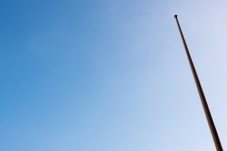 Flagpole is not a flag and clear blue sky