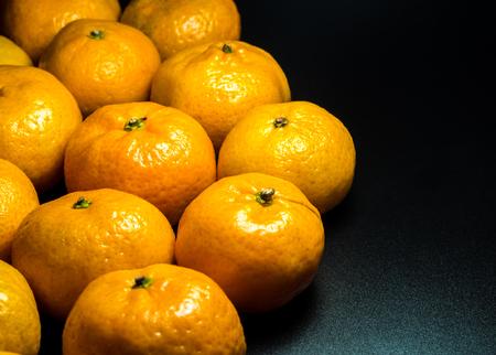 Close-up on glossy surface of freshness orange fruits