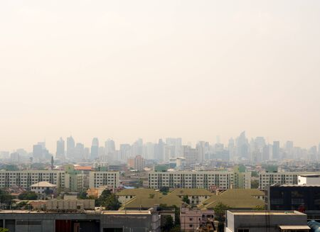 Bangkok City downtown cityscape urban skyline in the mist or smog. Wide and High view image of Bangkok city in the smog Stock Photo