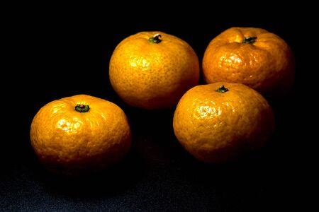 Close-up on glossy surface of freshness orange fruits 写真素材 - 132064357