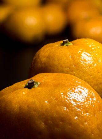 Close-up on glossy surface of freshness orange fruits 写真素材 - 132064323