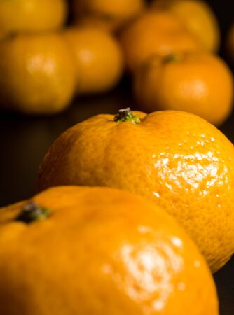 Close-up on glossy surface of freshness orange fruits 写真素材 - 132064857