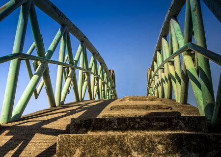Concrete bridge across the canal and the strong bridge rail