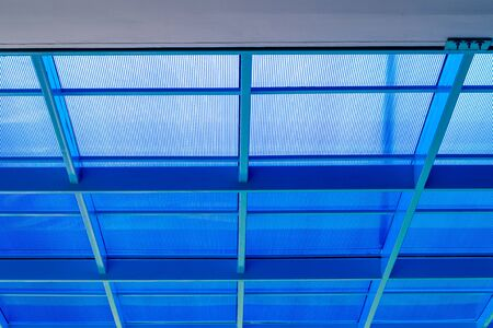 Steel frame and blue polycarbonate plastic roof