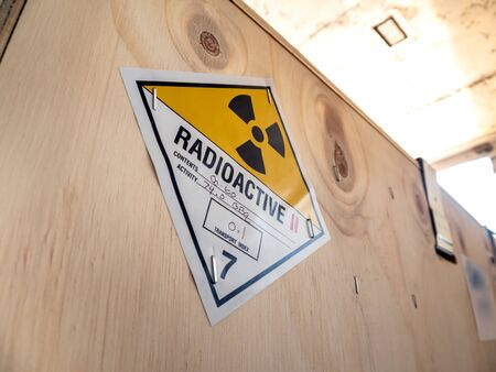 Radioactive material label beside the transportation wooden box Type A standard package