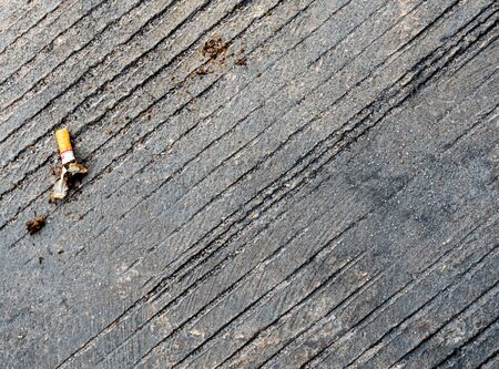 The cigarette butt let down on the concrete floor