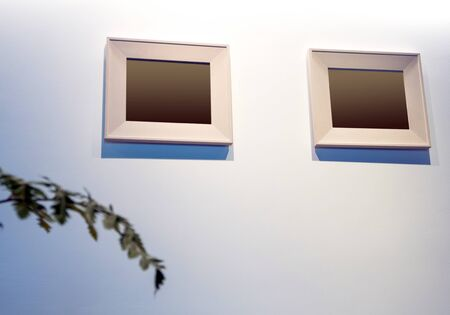 The blank wooden picture frame on the wall Standard-Bild