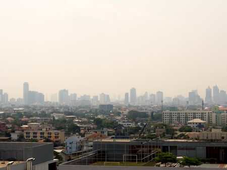 Bangkok City downtown cityscape urban skyline in the mist or smog. Wide and High view image of Bangkok city in the smog