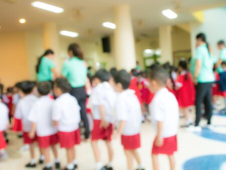 The blurred ambiance of teachers and kindergarten students to use as a background image