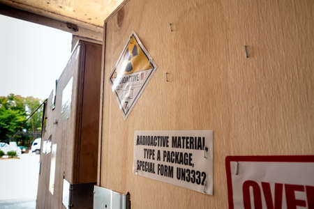 Radioactive material label beside the transportation wooden box Type A standard package in the truck Foto de archivo