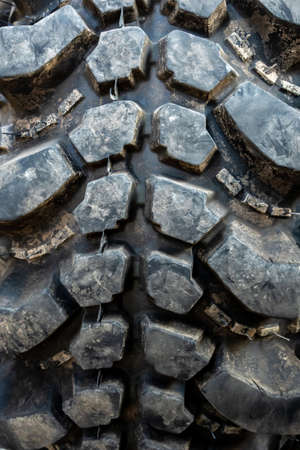 The texture of Centipede pattern mud terrain tire, Old used tires 写真素材