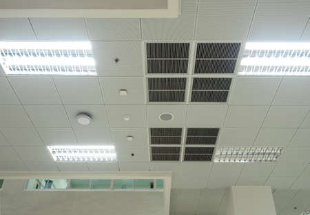 Air conditioning mask, lighting and modern equipment On the ceiling, selected switch-off some lighting for energy save