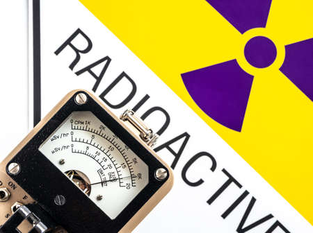 Hand-held radiation survey instrument detecting at the radioactive material symbol on label