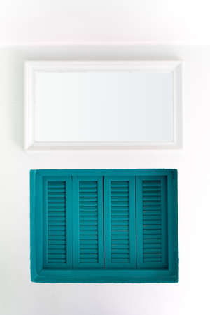 Blue wooden windows that are sealed on white walls