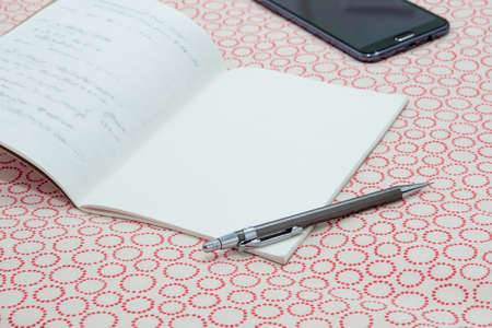 A notebook and pen on Table cloths Foto de archivo
