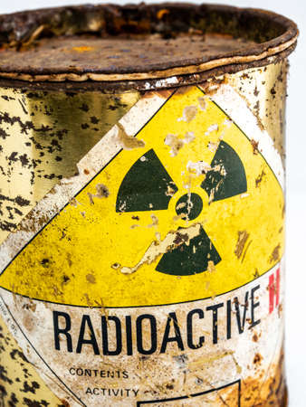 Radiation warning sign on transport index label stick on the rust and decay radioactive material container, Ionizing radiation hazard symbol as background Standard-Bild