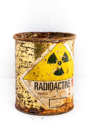 Radiation warning sign on transport index label stick on the old and rusted cylinder shape container of Radioactive material