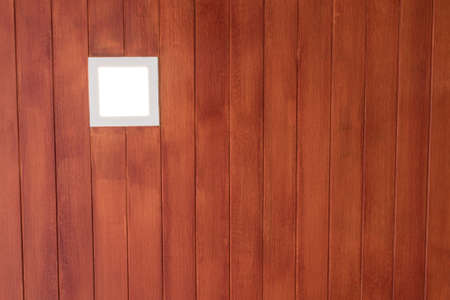 A Recessed lamp in artificial wood ceiling