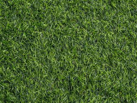 Texture of plastic artificial grass of school yard