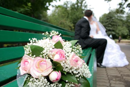 bouqet: bride and groom on the bench