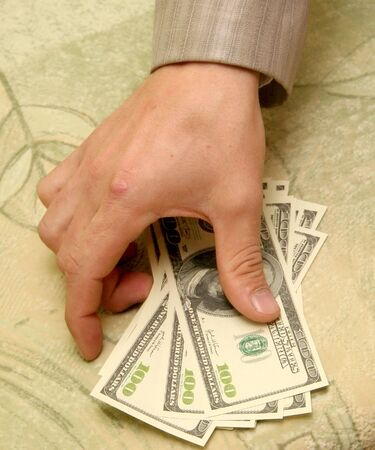 one lane sign: hand of man getting money Stock Photo