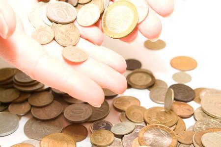buisness woman: dropiing old metallic money from woman hands Stock Photo