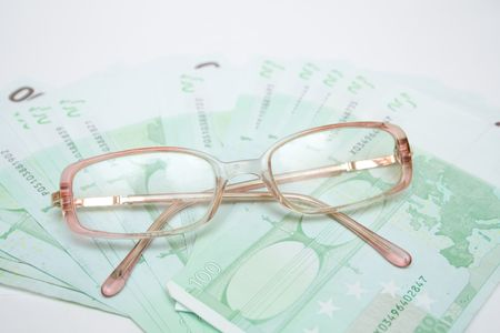 cashing: modern eyeglasses over money euro