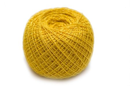 ball lump: yellow sewing clew on the white isolated background