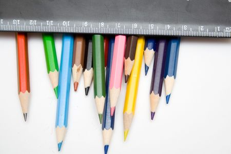 whie: multicolored pencils and black ruller on the whie isolated background Stock Photo