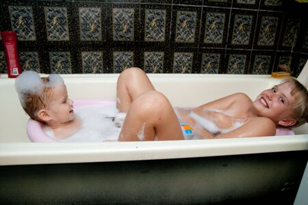 sisters playing in bath photo