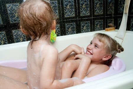 dirty blond: sisters playing in bath