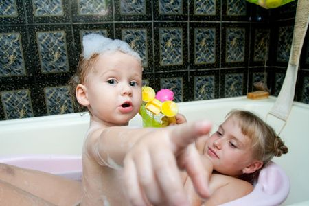 bath time: sisters playing in bath
