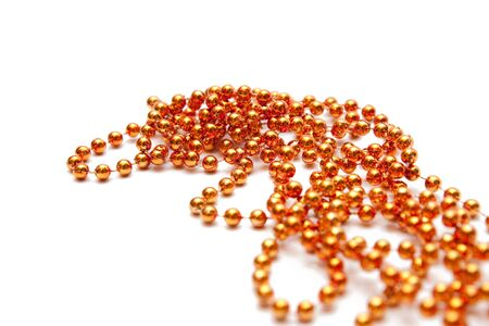 golden beads isolated on white photo