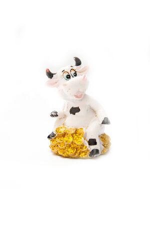 cow statuette isolated on white photo