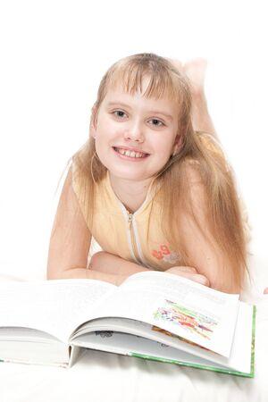 girl rading book isolated on white Stock Photo - 4242023