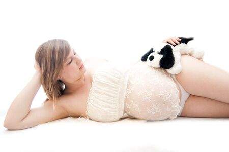 natural childbirth: pregnant woman lie on white isolated background