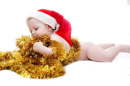 baby boy in Santa red hat isolated on white photo