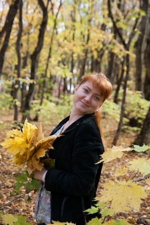 Romantic girl in autumn park photo