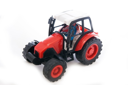 Tractor red toy on white photo