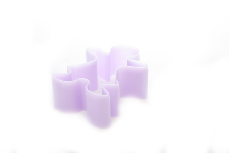 Man plastic cookies cutter isolated on white photo