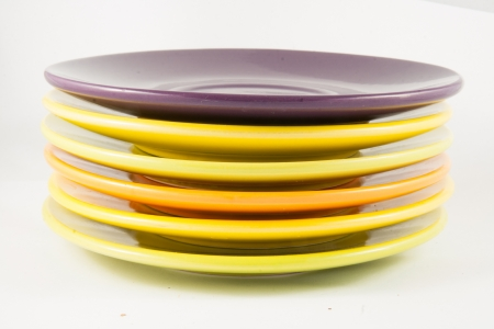 Colorful plates stacked one above the other Фото со стока