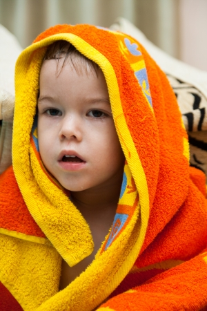 baby after the bath under towel photo