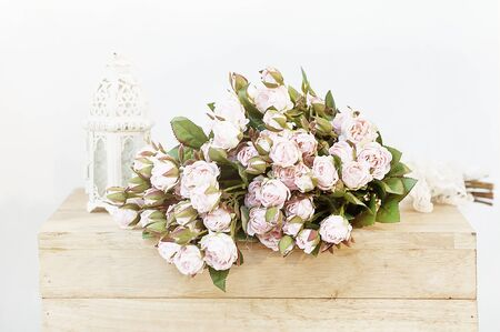 Vintage Pink roses bouquet over wooden table