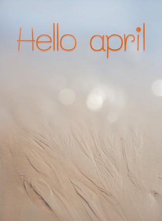 Hello april text on sand