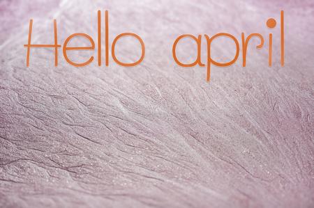 Hello april text on pink sand backgrounds 版權商用圖片