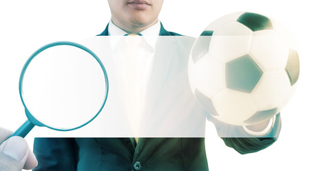 Double exposure of Magnifier searching and Business holding football on white background