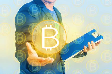 Double exposure of Businessman invite of handshake on bitcoin orange light 版權商用圖片
