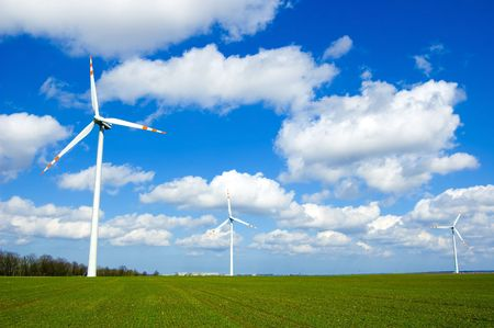 Windmill conceptual image. Windmills on the green field. Stock Photo - 7577734
