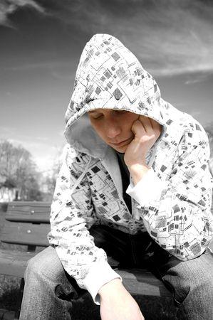 Emotion conceptual image. Depressed teenager. photo
